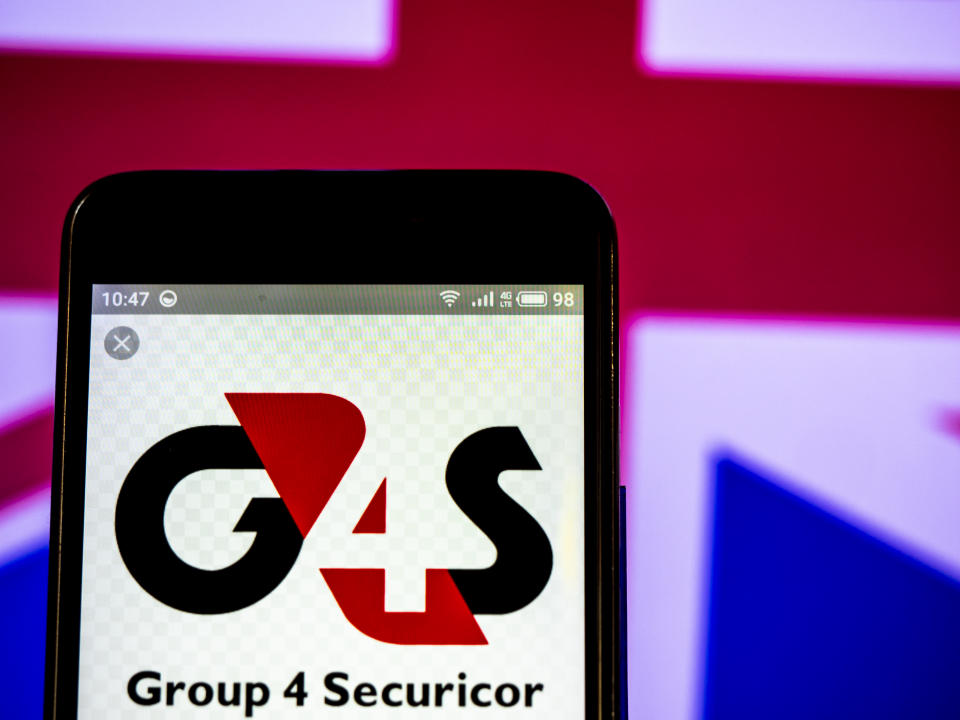 UKRAINE - 2019/03/09:  In this photo illustration, the G4S plc company logo seen displayed on a smartphone. (Photo Illustration by Igor Golovniov/SOPA Images/LightRocket via Getty Images)