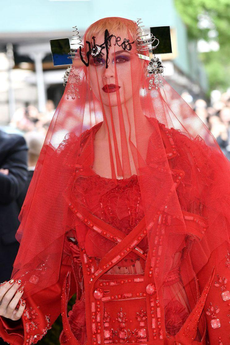 <p>Pat McGrath herself did host Katy Perry's makeup for the night, so it's no wonder the look couldn't be concealed even by a veil. She wore Dark Star 006 in Ultraviolet Blue, paired with Lust 004. (Photo: Rex) </p>
