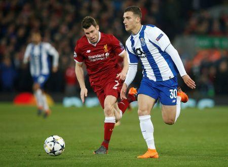 FILE PHOTO: Champions League Round of 16 Second Leg - Liverpool vs FC Porto - Anfield, Liverpool, Britain - March 6, 2018 Porto's Diogo Dalot in action with Liverpool's James Milner REUTERS/Andrew Yates