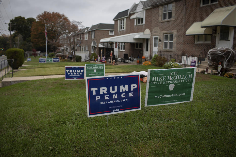 Campaign signs to re-elect Donald Trump for president adorn the yards of many homes in the Philadelphia suburb of Chester, Pa. on Wednesday, Oct. 28, 2020. (AP Photo/Robert Bumsted)