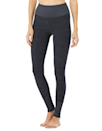 """Low-impact workouts like barre, (hot) yoga, and pilates call for comfortable fabrics and fits that move without you noticing. Harris says its Alosoft collection is perfect for that. The material is lightweight and has a velvety quality to it, while the ribbed waistband and ankle cuffs keep the legging locked in place. $98, Alo Yoga. <a href=""""https://www.aloyoga.com/products/w5762r-high-waist-alosoft-lounge-legging-rich-navy-heather"""" rel=""""nofollow noopener"""" target=""""_blank"""" data-ylk=""""slk:Get it now!"""" class=""""link rapid-noclick-resp"""">Get it now!</a>"""