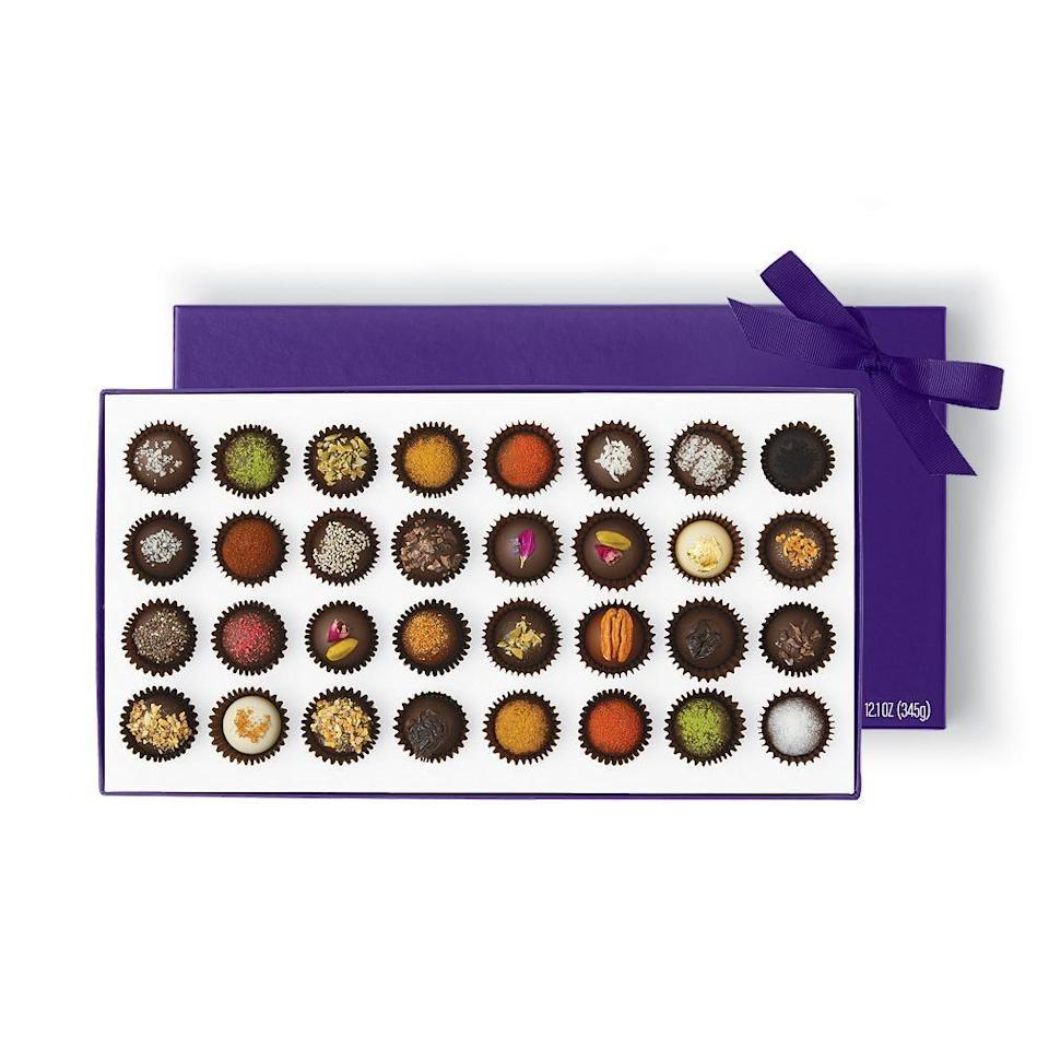 "<h2><a href=""https://www.vosgeschocolate.com/collections/sacred-love-valentines-day-collection"" rel=""nofollow noopener"" target=""_blank"" data-ylk=""slk:Vosges Chocolate"" class=""link rapid-noclick-resp"">Vosges Chocolate</a></h2><br><a href=""https://www.vosgeschocolate.com/"" rel=""nofollow noopener"" target=""_blank"" data-ylk=""slk:Vosges"" class=""link rapid-noclick-resp"">Vosges</a> website states: ""We are on an everlasting quest for ingredients at the pinnacle of their taste profile, making it our mission to carefully select the finest ingredients Mother Nature and our farmer and artisan partners have to offer."" And that's exactly what they do with their luxe truffle collections, <a href=""https://www.vosgeschocolate.com/pages/chocolate-bars"" rel=""nofollow noopener"" target=""_blank"" data-ylk=""slk:chocolate bar gift sets,"" class=""link rapid-noclick-resp"">chocolate bar gift sets,</a> and <a href=""https://www.vosgeschocolate.com/collections/gifts-under-25/products/northwoods-cranberry-pecan-toffee"" rel=""nofollow noopener"" target=""_blank"" data-ylk=""slk:Northwoods Cranberry Pecan Toffee"" class=""link rapid-noclick-resp"">Northwoods Cranberry Pecan Toffee</a>. Plus, you can use code SACRED15 for 15% off your V-Day order. <br><br><strong>Vosges Chocolate</strong> Exotic Truffle Collection, $, available at <a href=""https://go.skimresources.com/?id=30283X879131&url=https%3A%2F%2Ffave.co%2F2W4CjKg"" rel=""nofollow noopener"" target=""_blank"" data-ylk=""slk:Vosges Chocolate"" class=""link rapid-noclick-resp"">Vosges Chocolate</a>"