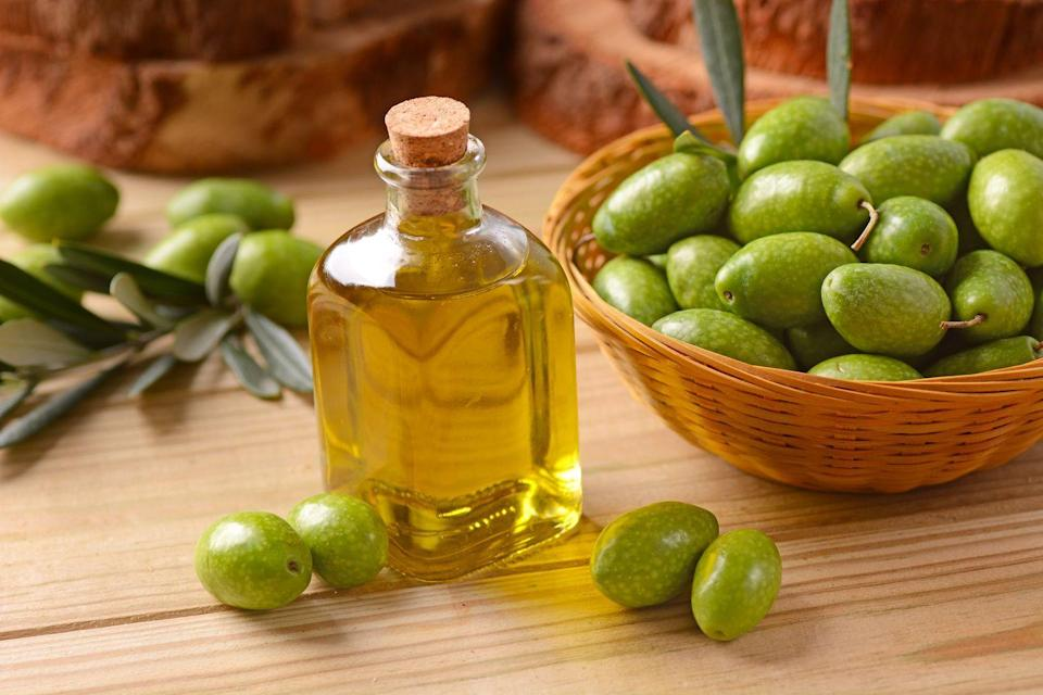 """<p>Extra virgin olive oil (EVOO) has been a culinary staple for more reasons than it's plain delicious. It's proven to help reduce inflammation, <a href=""""https://www.prevention.com/health/health-conditions/g26576559/foods-for-high-blood-pressure/"""" rel=""""nofollow noopener"""" target=""""_blank"""" data-ylk=""""slk:lower blood pressure"""" class=""""link rapid-noclick-resp"""">lower blood pressure</a>, and improve insulin sensitivity, Dixon says. </p><p>""""Extra virgin olive oil has an excellent record of research demonstrating benefits to the cardiovascular system, which is particularly important to note these days, given the fact that <a href=""""https://www.prevention.com/health/a20516946/surprising-heart-attack-risk/"""" rel=""""nofollow noopener"""" target=""""_blank"""" data-ylk=""""slk:heart disease"""" class=""""link rapid-noclick-resp"""">heart disease</a> is the number one killer in the U.S.,"""" says Dixon. </p><p>Make a <a href=""""https://www.prevention.com/food-nutrition/recipes/g26822167/whole30-salad-dressing-recipes/"""" rel=""""nofollow noopener"""" target=""""_blank"""" data-ylk=""""slk:homemade salad dressing"""" class=""""link rapid-noclick-resp"""">homemade salad dressing</a> with EVOO, drizzle some over veggies before roasting them to get them nice and crisp, and sub it in for butter in recipes to reduce saturated fat.</p>"""
