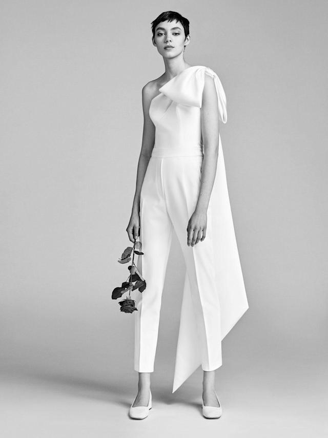 <p>Model wears a one-shoulder white jumpsuit from the Spring 2018 Bridal collection. (Photo: Courtesy of Viktor & Rolf) </p>
