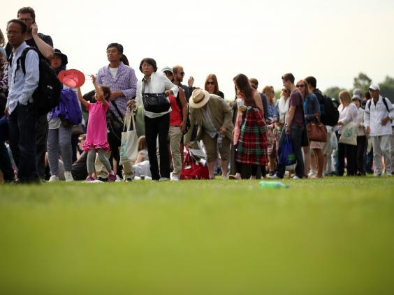 Punters queuing to attend The Championships (Getty)