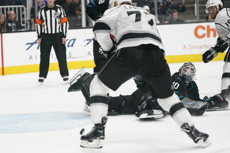 San Jose Sharks goaltender Aaron Dell (30) looks back as Los Angeles Kings center Jeff Carter (77) scores in overtime in an NHL hockey game in San Jose, Calif., Friday, Dec. 27, 2019. The Kings won 3-2. (AP Photo/Tony Avelar)