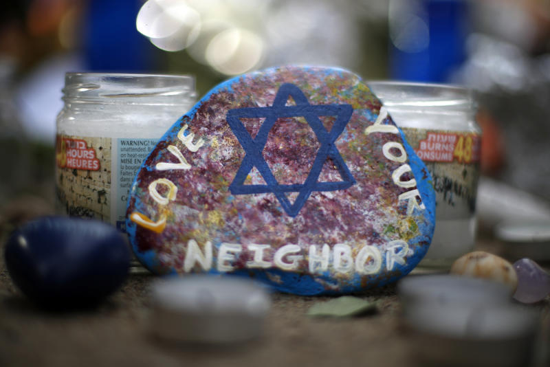 FILE - This Wednesday, Oct. 31, 2018, file photo, shows a painted rock found as part of a makeshift memorial outside the Tree of Life Synagogue in the Squirrel Hill neighborhood of Pittsburgh, in honor of the people killed during worship services several days earlier. On Tuesday, April 30, 2019, a Jewish civil rights group says anti-Semitic attacks in the U.S. remained near a record-high level in 2018, partially fueled by a sharp increase in physical assaults. (AP Photo/Gene J. Puskar, File)