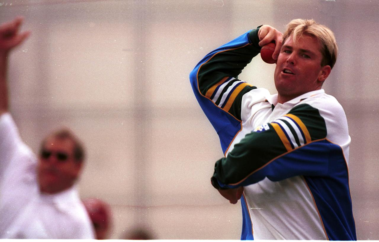 4 Nov 1999:  Leg spin bowler Shane Warne of Australia bowls under the close scrutiny of bowling coach Terry Jenner during net practice ahead of the First Test Match against Pakistan at The Gabba, Brisbane, Australia. Mandatory Credit: Jack Atley/ALLSPORT