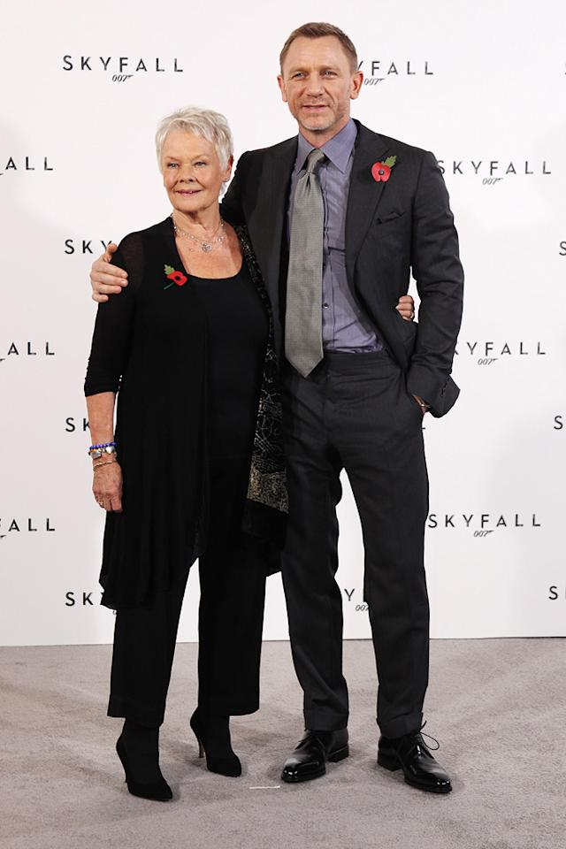 """<a href=""""http://movies.yahoo.com/movie/contributor/1800011678"""">Judi Dench</a> and <a href=""""http://movies.yahoo.com/movie/contributor/1800023173"""">Daniel Craig</a> attend a photocall with cast and filmmakers to mark the start of production which is due to commence on the 23rd Bond Film and announce the title of the film as """"Skyfall"""" on November 3, 2011 in London."""