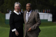 Lee Elder and his wife Sharon posed for a picture on the first tee at the Masters golf tournament Monday, Nov. 9, 2020, in Augusta, Ga. Fred Ridley, Chairman of Augusta National Golf Club, announced today that Lee Elder, the first Black man to compete in the Masters Tournament 45 years ago, will be honored by establishing scholarships in his name and inviting him to be an Honorary Starter for the 2021 Masters. (AP Photo/Chris Carlson)