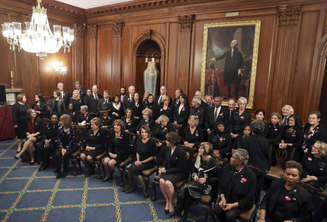 House Minority Leader Nancy Pelosi, D-Calif., center seated, with other House members wearing black in support the #MeToo and Time's Up movements, pose for a group photo ahead of tonight's State of the Union address on Capitol Hill in Washington, Jan. 30, 2018. (Photo: Pablo Martinez Monsivais/AP)