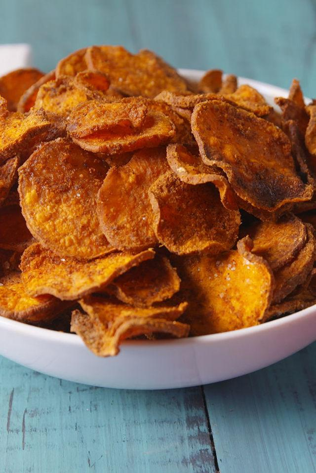 "<p>Slice the sweet potatoes as thinly as possible to maximize the crispiness potential! </p><p>Get the recipe from <a rel=""nofollow"" href=""http://www.delish.com/cooking/recipe-ideas/recipes/a49369/sweet-potato-chips-recipe/"">Delish</a>.</p>"