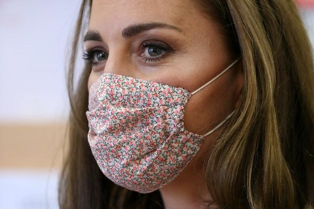 Kate picked a floral mask to wear to for the charity visit