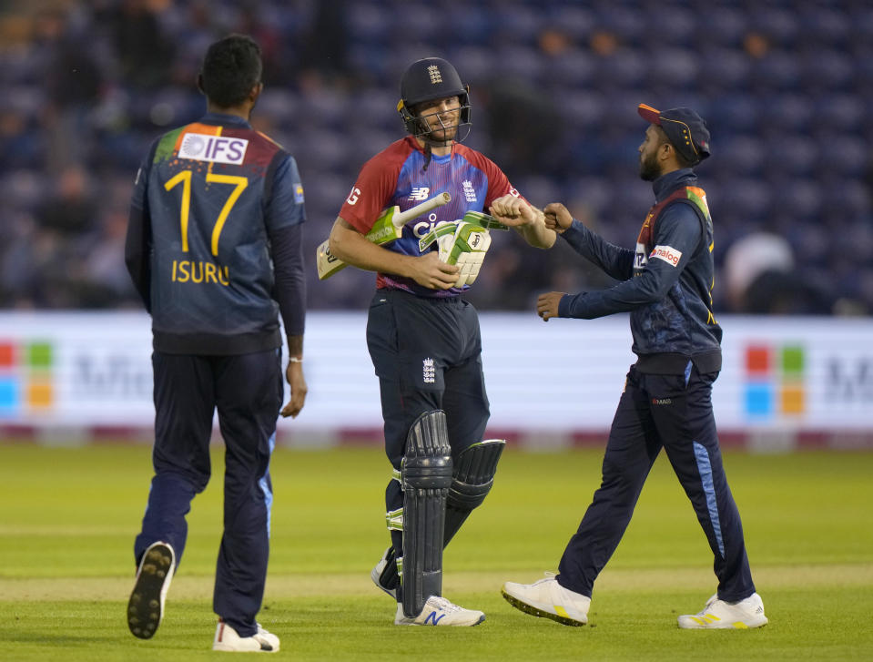 England's Jos Buttler celebrates and acknowledges the congratulations of the Sri Lankan team after England won the T20 international cricket match between England and Sri Lanka at Cardiff, Wales, Wednesday, June 23, 2021. (AP Photo/Alastair Grant)