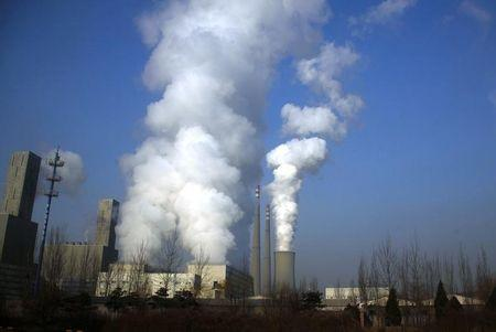 Smoke billows from the chimneys of a coal-burning power station in central Beijing