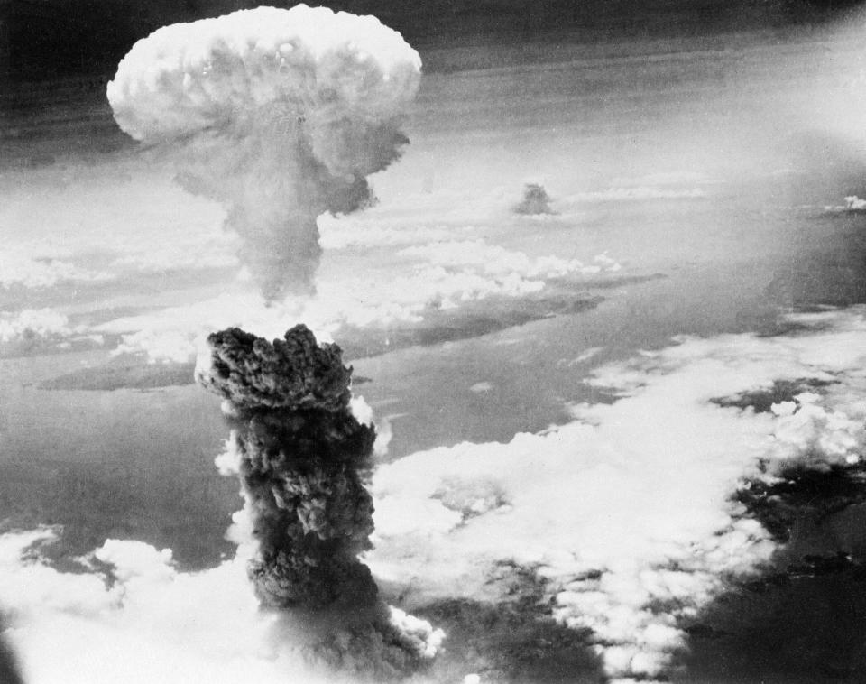 FILE - In this Aug. 9, 1945, file photo, a giant column of smoke rises after the second atomic bomb ever used in warfare explodes over the Japanese port town of Nagasaki. The city of Nagasaki in southern Japan marks the 75th anniversary of the U.S. atomic bombing of Aug. 9, 1945. Japan surrendered on Aug. 15, ending World War II and its nearly a half-century aggression toward Asian neighbors. Dwindling survivors, whose average age exceeds 83, increasingly worry about passing their lessons on to younger generations. (AP Photo, File)