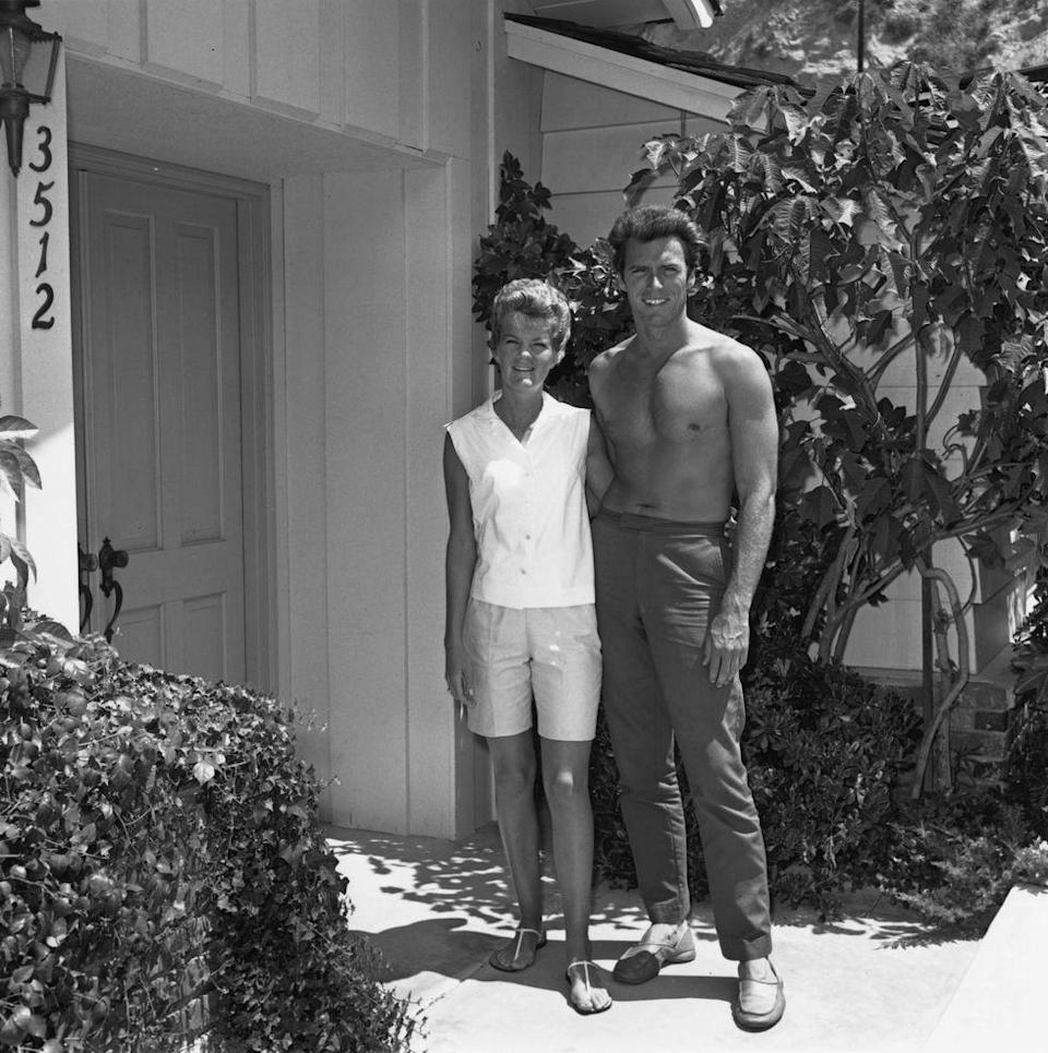 """<p>In 1953, Eastwood met Maggie Johnson, a model working in Los Angeles. The pair were set up on a blind date and <a href=""""https://abcnews.go.com/Entertainment/clint-eastwoods-women/story?id=20235215"""" rel=""""nofollow noopener"""" target=""""_blank"""" data-ylk=""""slk:got married six months later"""" class=""""link rapid-noclick-resp"""">got married six months later</a>. </p>"""