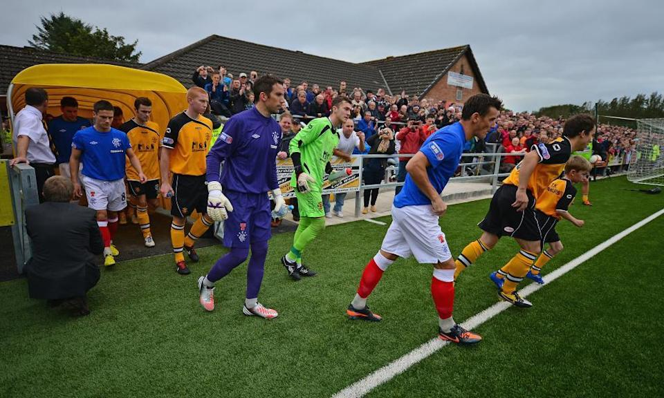 Annan Athletic and Rangers players make their way on to the pitch for the Scottish Third Division match at Galabank Stadium in September 2012