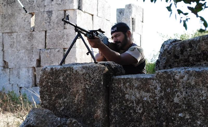 """This citizen journalism image provided by Shaam News Network SNN, taken on Monday, July 4, 2012, purports to show a Free Syrian Army soldier aiming his weapon in the northern town of Sarmada, in Idlib province, Syria. Syria's military began large-scale exercises simulating defense against outside """"aggression,"""" the state-run news agency said Sunday an apparent warning to other countries not to intervene in the country's crisis. (AP Photo/Shaam News Network, SNN)THE ASSOCIATED PRESS IS UNABLE TO INDEPENDENTLY VERIFY THE AUTHENTICITY, CONTENT, LOCATION OR DATE OF THIS HANDOUT PHOTO"""