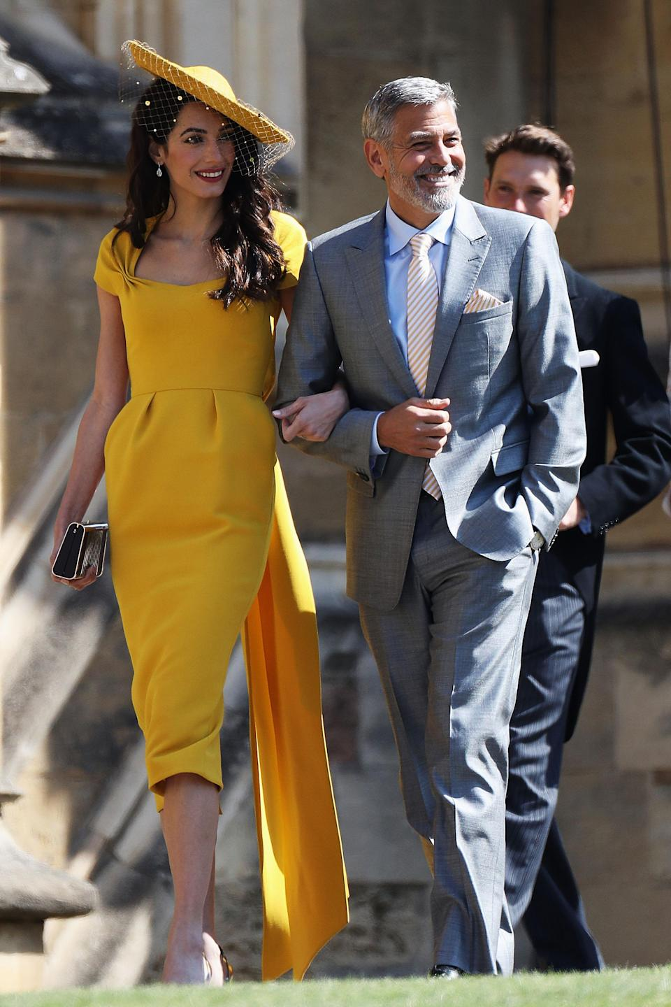 Amal and George Clooney arrive at St. George's Chapel. (Photo: Getty Images)