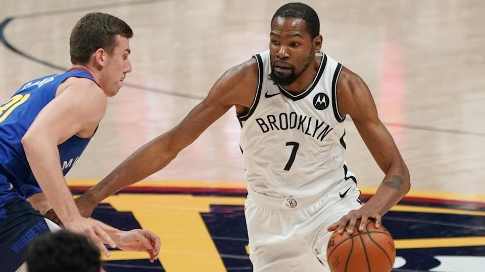 Nets Kevin Durant white jersey dribbles vs Nuggets