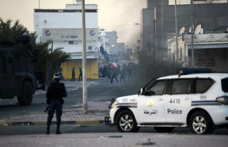 Protesters throw stones at riot police during clashes in the Shiite village of Shahrakkan, south of Manama on April 5, 2016 after the funeral of a 17-year-old whose family says he died of injuries suffered in a police chase
