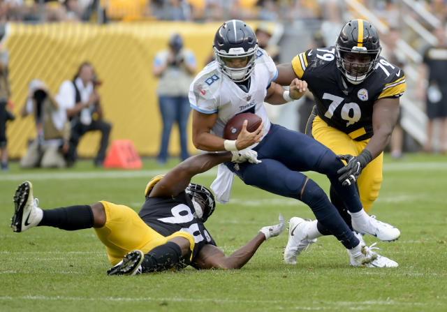 Tennessee Titans quarterback Marcus Mariota (8) is sacked by Pittsburgh Steelers linebacker Vince Williams (98) and defensive tackle Javon Hargrave (79) in the first half of an NFL football game, Saturday, Aug. 25, 2018, in Pittsburgh. (AP Photo/Fred Vuich)
