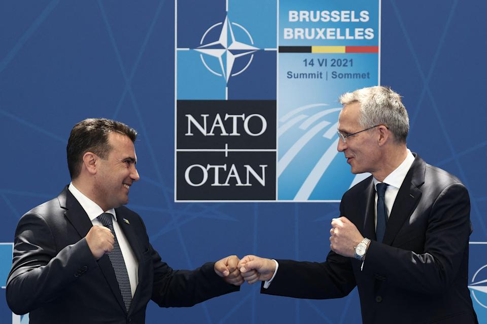 North Macedonia's Prime Minister Zoran Zaev (L) is greeted by Nato Secretary General Jens Stoltenberg (R) during the Nato summit (POOL/AFP via Getty Images)