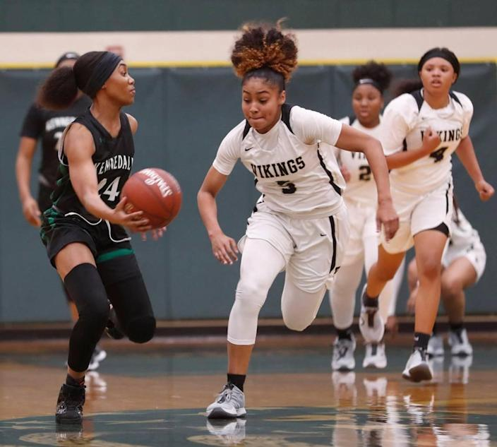 Kennedale guard Jayla Harvey (24) passes the ball across court in front of Pinkston guard Victoria Flores (5) during the first half of a 4A Region 2 quarterfinal basketball game at DeSoto High School in DeSoto, Texas, Wednesday, Feb. 24, 2021. Pinkston led Kennedale 19-11 at the half. (Special to the Star-Telegram Bob Booth)