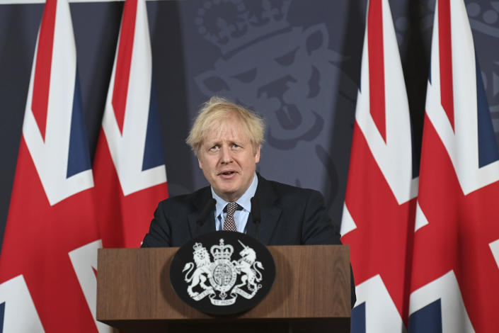 Britain's Prime Minister Boris Johnson speaks during a media briefing in Downing Street, London, Thursday, Dec. 24, 2020. Britain and the European Union have struck a provisional free-trade agreement that should avert New Year's chaos for cross-border commerce and bring a measure of certainty to businesses after years of Brexit turmoil. The breakthrough on Thursday came after months of tense and often testy negotiations that whittled differences down to three key issues: fair-competition rules, mechanisms for resolving future disputes and fishing rights. (Paul Grover/Pool Photo via AP)