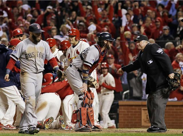 FILE - In this Oct. 26, 2013, file photo, Boston Red Sox catcher Jarrod Saltalamacchia, center, argues an obstruction call with home plate umpire Dana DeMuthm, right, in the ninth inning of Game 3 of baseball's World Series in St. Louis. (AP Photo/Matt Slocum, File)