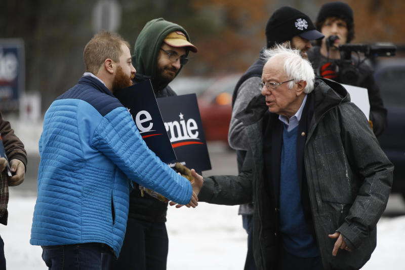 Sen. Bernie Sanders, I-Vt., meets with people outside a polling place where voters will cast their ballots in a primary election, in Manchester, N.H. (Matt Rourke/AP)