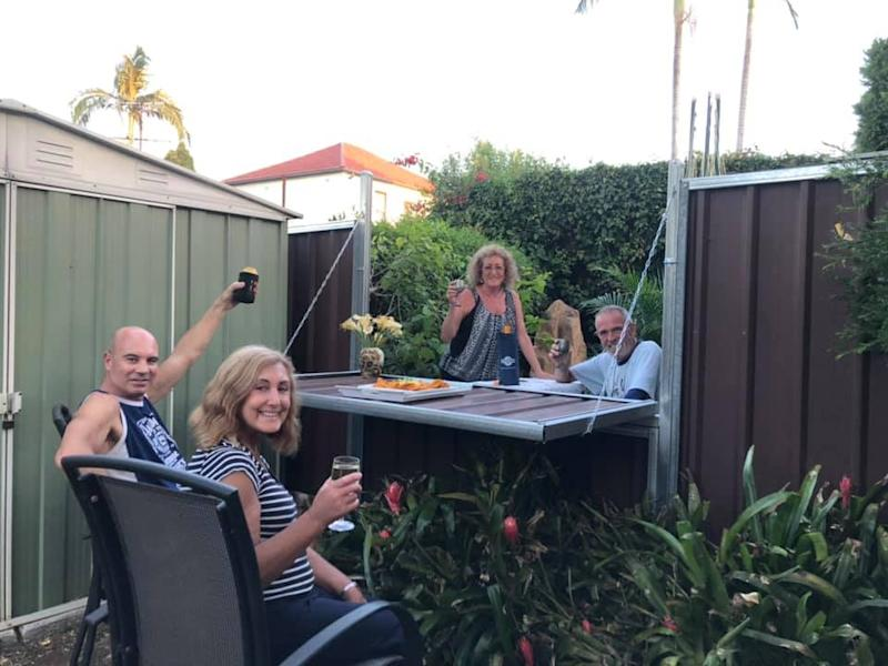 NSW couples Lee and Linda Solomons and Jackie and Tony Cliffe fence DIY allows social distancing drinks