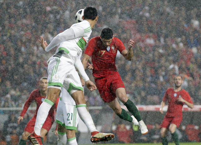 Portugal's Goncalo Guedes scores 3rd goal for his team during a friendly soccer match between Portugal and Algeria in Lisbon, Portugal, Thursday, June 7, 2018. (AP Photo/Armando Franca)