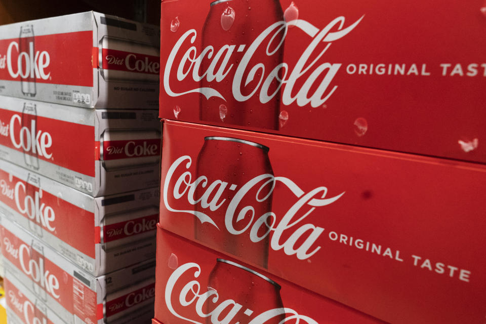 Cases of Coca-Cola are displayed in a supermarket, Monday, April 5, 2021 in New York. Rising prices for a variety of commodities are contributing to a jump in prices at the consumer level, with Americans paying more for meat, gasoline, items they keep in their homes and even the homes themselves. (AP Photo/Mark Lennihan)