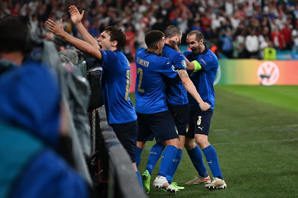Italy's defender Leonardo Bonucci (2R) celebrates with Italy's defender Giorgio Chiellini (R) after scoring the team's first goal during the UEFA EURO 2020 final football match between Italy and England at the Wembley Stadium in London on July 11, 2021. (Photo by Paul ELLIS / POOL / AFP) (Photo by PAUL ELLIS/POOL/AFP via Getty Images)