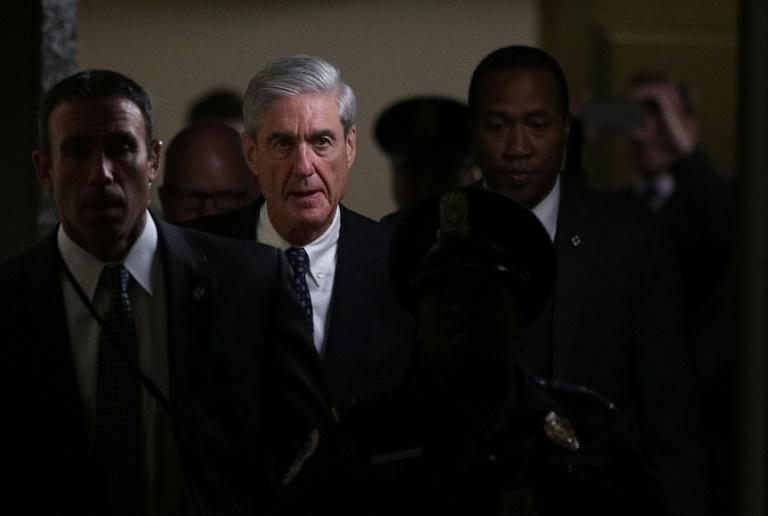 Special Counsel Robert Mueller (2nd L) worked quickly on one of the most disturbing investigations in US history: did President Donald Trump and his campaign collude with Russia?