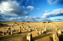 The peculiar pinnacles at Nambung National Park, Western Australia - These amazing natural limestone structures, some standing as high as five metres, were formed approximately 25,000 to 30,000 years ago after the sea receded and left deposits of sea shells. Over time, coastal winds removed the surrounding sand leaving the pillars exposed. PIC BY JEAN PAUL FERRERO / ARDEA / CATERS NEWS