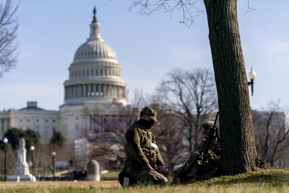 Members of the National Guard work outside the U.S Capitol building on Capitol Hill in Washington, Thursday, Jan. 14, 2021. (AP Photo/Andrew Harnik)