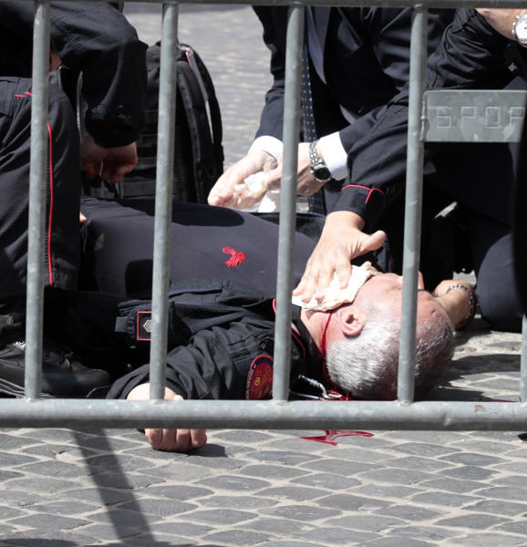 A wounded Carabinieri paramilitary police officer lies on the ground after being shot outside the Chigi Premier's office, in Rome, Sunday, April 28, 2013. Two paramilitary police officers were shot and wounded Sunday in a crowded square outside the Italian premier's office as the new leader Enrico Letta was sworn in about a kilometer (half-mile) away. It was unclear if there was any connection between the events. (AP Photo/Gregorio Borgia)