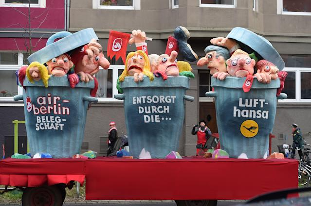 "<p>A carnival float, depicting people in bins, is pictured during a carnival parade on Rose Monday on Feb. 12, 2018 in Duesseldorf, western Germany. The writings read ""Air Berlin employees, dummped by Lufthansa"". Germany. (Photo: Patrik Stollarz/Getty Images) </p>"