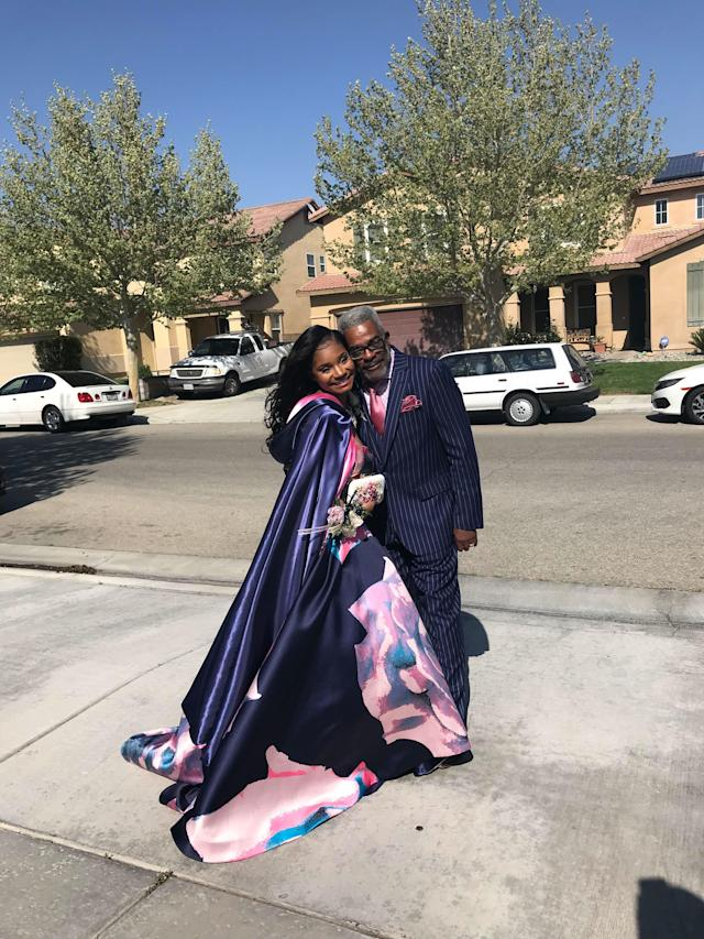 Kaylah Bell poses with her dapper grandpa who stood in as her date when she couldn't find one. (Credit: Kaylah Bell)