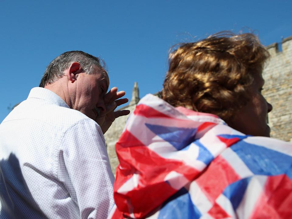 A man wipes his tears during a minute's silence for the funeral of Britain's Prince PhilipREUTERS