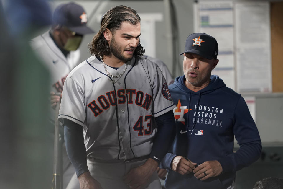 Houston Astros starting pitcher Lance McCullers Jr., left, walks in the dugout after finishing the sixth inning of the team's baseball game against the Seattle Mariners, Tuesday, July 27, 2021, in Seattle. (AP Photo/Ted S. Warren)