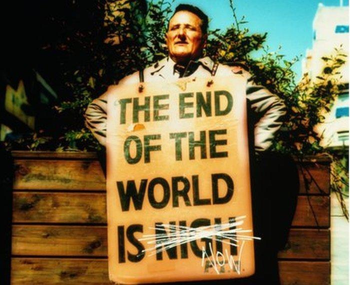Man with `the end of the world is nigh` placard