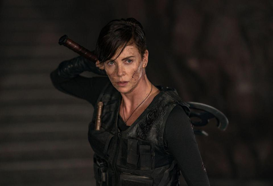 """<p>Surprising no one, if you're familiar with her work, Theron is great in this. She's Andy, full name Andromache the Scythian—and she's been alive for a really, really long time. She doesn't specify in the film, but <a href=""""https://youtu.be/khCUVWqW9BU"""" rel=""""nofollow noopener"""" target=""""_blank"""" data-ylk=""""slk:a companion history video"""" class=""""link rapid-noclick-resp"""">a companion history video</a> specifies 4800 B.C. as the date she learned she couldn't die—making her almost 7,000 years old, if my math is right. </p>"""