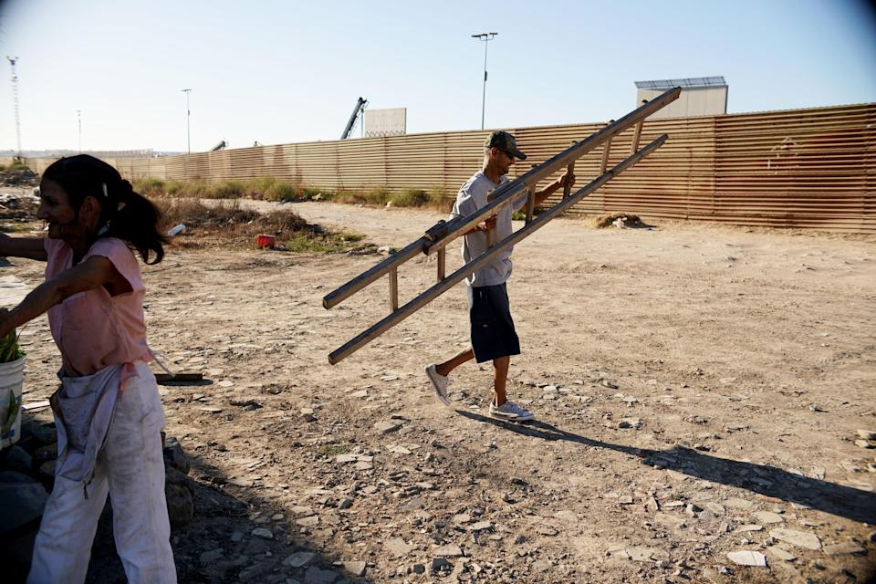 <p>Migrants are reportedly crossing the US-Mexico border wall with $5 ladders</p> (Getty Images)
