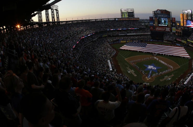 Fans watch the opening ceremony before the MLB All-Star baseball game, on Tuesday, July 16, 2013, in New York. (AP Photo/Julio Cortez)