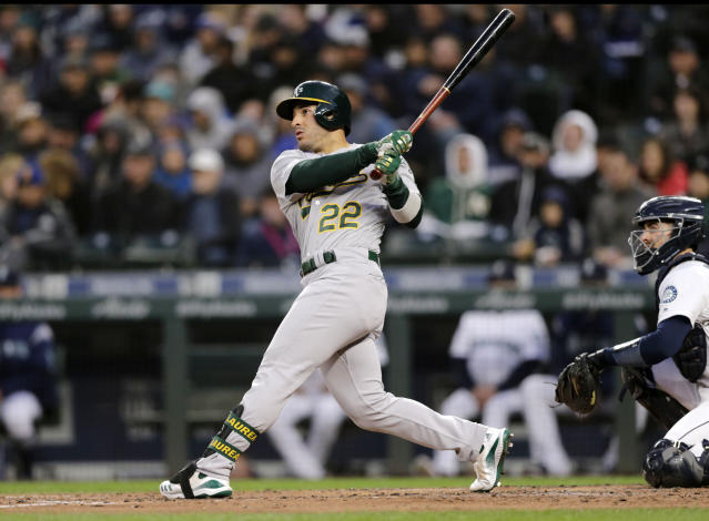 Oakland Athletics' Ramon Laureano hits a solo home run on a pitch from Seattle Mariners starting pitcher Marco Gonzales during the third inning of a baseball game, Saturday, Sept. 28, 2019, in Seattle. (AP Photo/John Froschauer)
