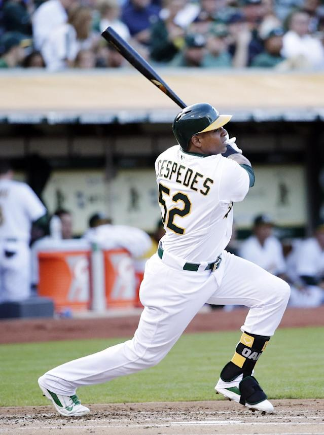 Oakland Athletics' Yoenis Cespedes doubles against the Houston Astros during the first inning of a baseball game on Tuesday, July 22, 2014, in Oakland, Calif. (AP Photo)
